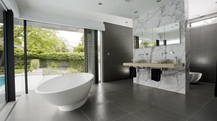 open plan showers - gray and white minimalist bath in Australian home - minosadesign via Atticmag