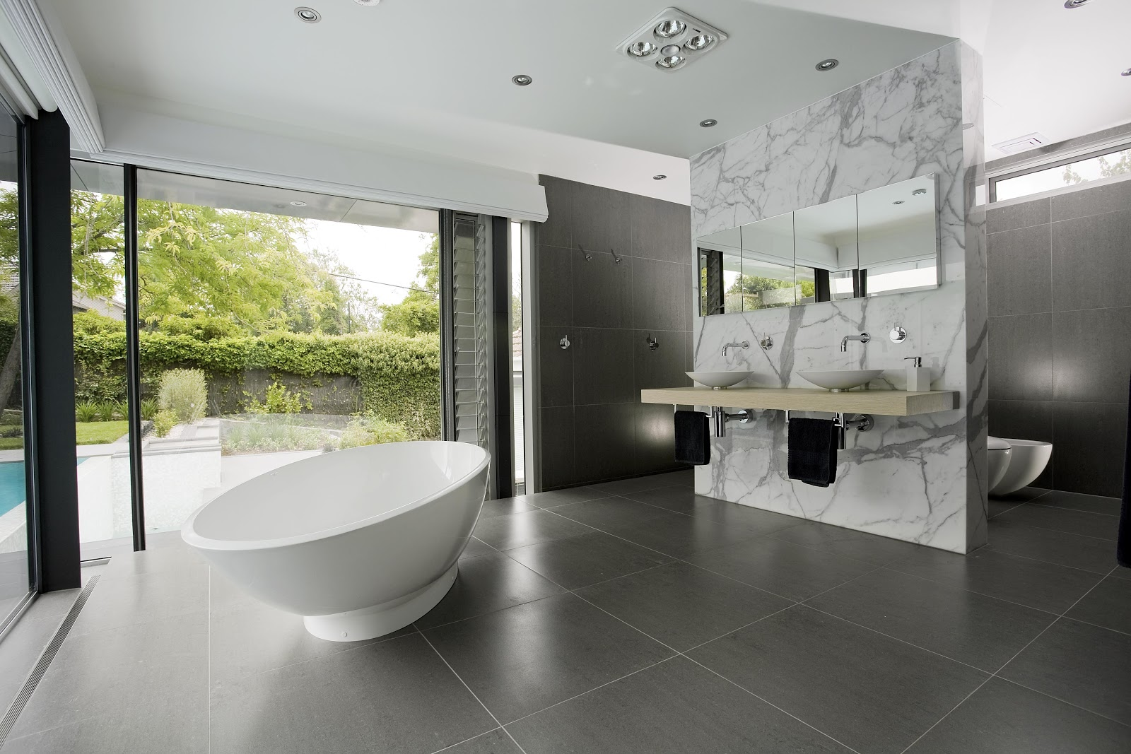open plan showers - gray and white minimalist bath in Australian home - minosadesign via Atticmag