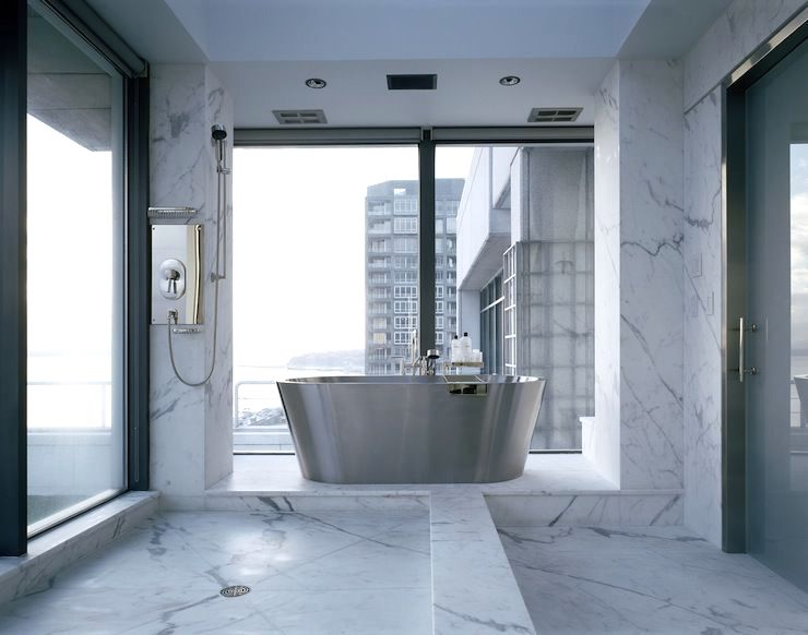 open plan showers - marble bath with shower mounted on corner column - Toth Construction via Atticmag