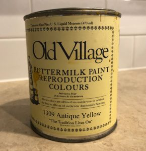 repurposed china cabinet with Old Village Antique Yellow buttermilk paint in the back - Atticmag
