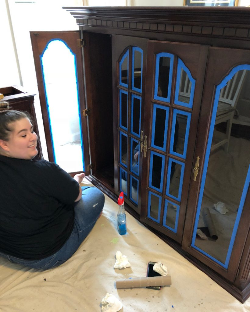 repurposed china cabinet, taping the Gothic doors on the top - Atticmag