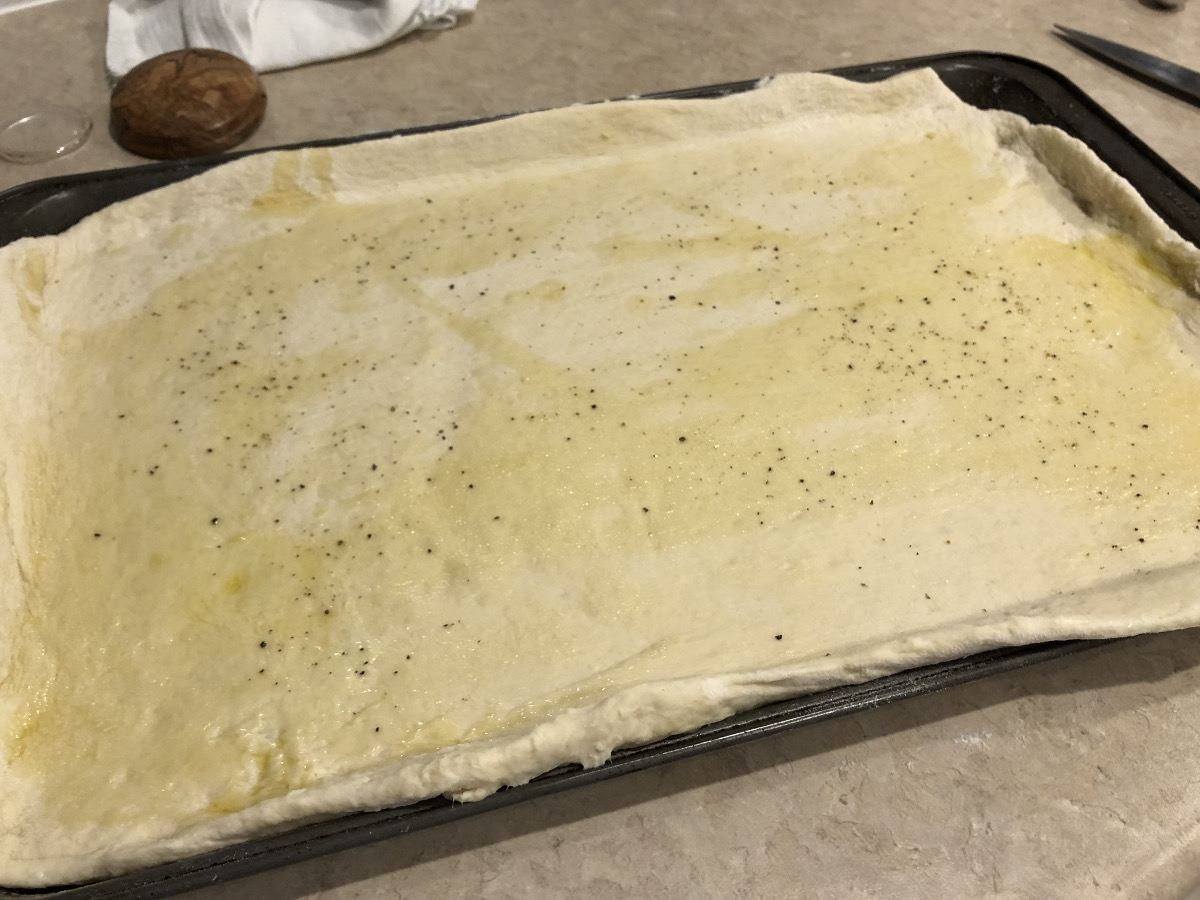 summer pizza - rolled out dough brushed with oil, salt and pepper - Atticmag