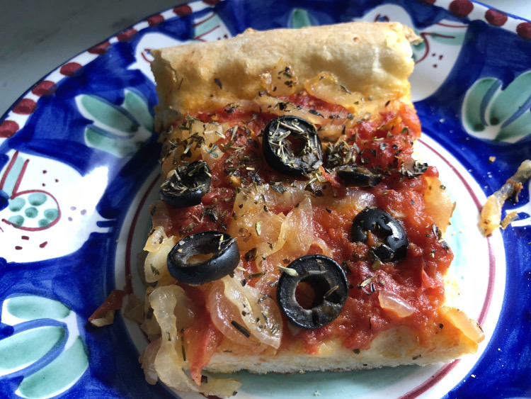 summer pizza - baked pizza is cut in squares for serving - Atticmag